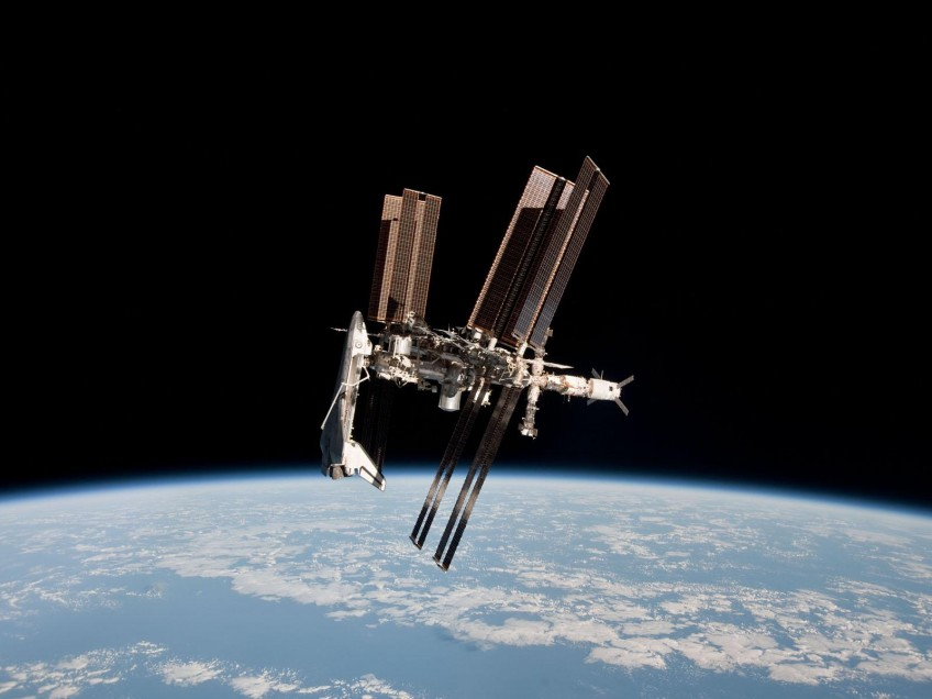 Stunning photograph of shuttle Endeavour docked to the ISS
